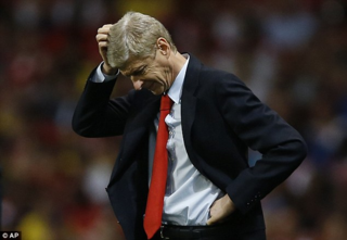Wenger scratches head
