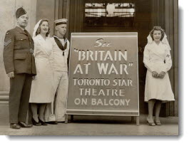 C.N.E. Crowds see first showing of Britain at war