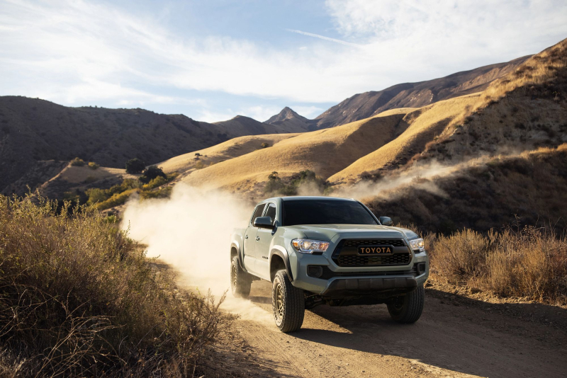 2022 Toyota Tacoma Trail Edition Front Profile On Dirt Road In Mountains