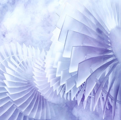A semi-abstract digital image showing turbine vanes, in shades of purple