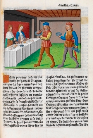 Servants carrying food to a royal couple seated at a table