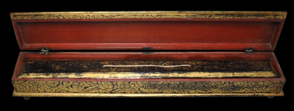 Wooden case with Kammavācā palm leaf manuscript in Tham script inside. The decoration of the manuscript covers is repeated on the case. Lanna or Laos, 19th century. British Library, Or.16893. Photograph courtesy of Michael Backman. © Michael Backmann Ltd.
