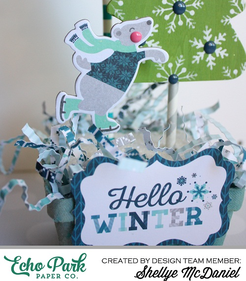 "This Winter Decor was created by Shellye McDaniel using the ""Hello Winter"" collection by #EchoParkPaper.  The Designer Stencils are featured on the snowflake covered paper trees. This project would be cute as a centerpiece, an accent piece, or even as a hostess gift!"
