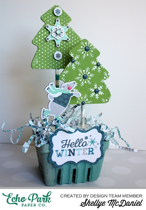 "This Winter Decor was created by Shellye McDaniel using the ""Hello Winter"" collection by #EchoParkPaper.  The Designer Stencils are featured on the snowflake covered paper trees. This project would be cute as a centerpiece, an accent piece, or even as a hostess gift!  The DIY tutorial is on the Echo Park blog!"