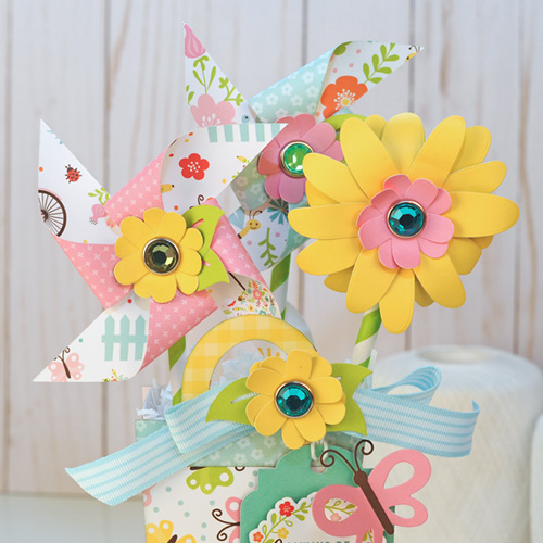 """Rainboot filled with flowers and pinwheels by Jana Eubank with the """"Hello Spring"""" collection by #EchoParkPaper"""