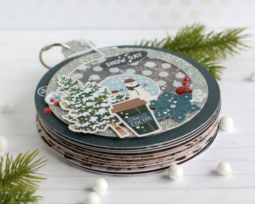 "Ornament shaped mini album by Anya Lunchenko featuring the ""Let it Snow"" collection by #CartaBellaPaper"