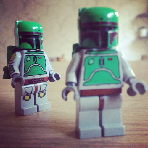 Two Boba Fett LEGO figurines, one blurred and one in the background