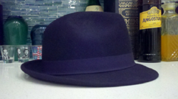 A black hat like this should be worn by a gentleman with a suit, not by a hipster who think he's being ironic.