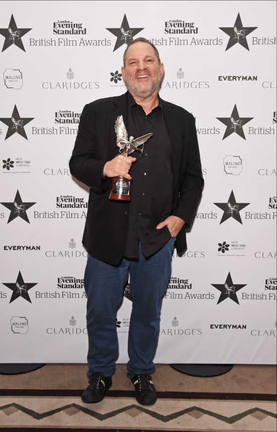 Harvey Weinstein receives the award for best international film at the London Evening Standard British Film Awards