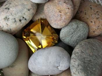 Rocks with a gem but just one gem, more rocks than gems.