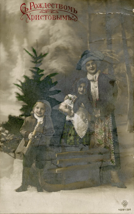 A mother and two children one with an axe standing in front of a tree the black and white photo his been coloured in green in certain places like the dresses and tree