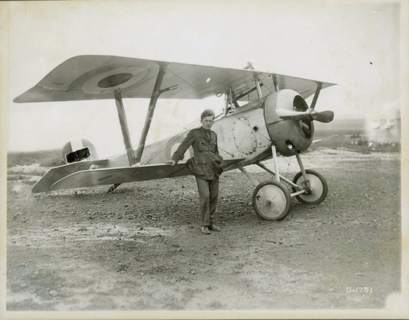 Billy bishop standing in front of plane